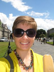 Trinity College, Dublin, June 2010. Have no idea what I'm wearing with it. Purple sunglasses from my mom, necklace from Anne.
