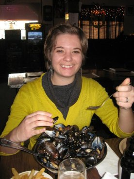 Eating way too many mussels, Cadieux Cafe in Detroit, December 2010. Gray cowl neck sweater dress from my mother-in-law. Awkward hair courtesy of me.