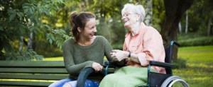 Elderly woman and caregiver.