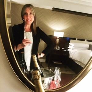Eileen Callahan enjoying Champagne delivery at the Ritz Carlton in Denver Colorado
