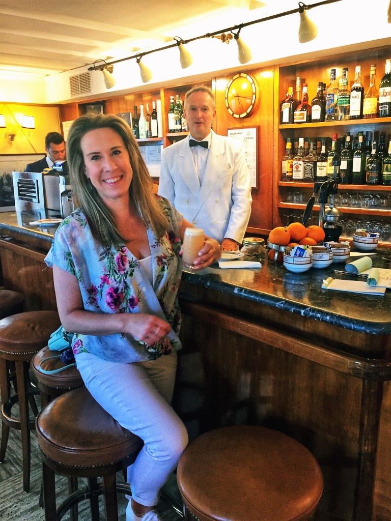 Eileen Callahan Luxury Travel Expert of Champagne Travels in Venice Italy At Harry's Bar enjoy a Bellini cocktail