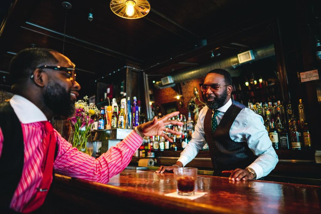 Two men talking at the bar