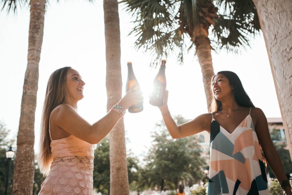 Two women toasting