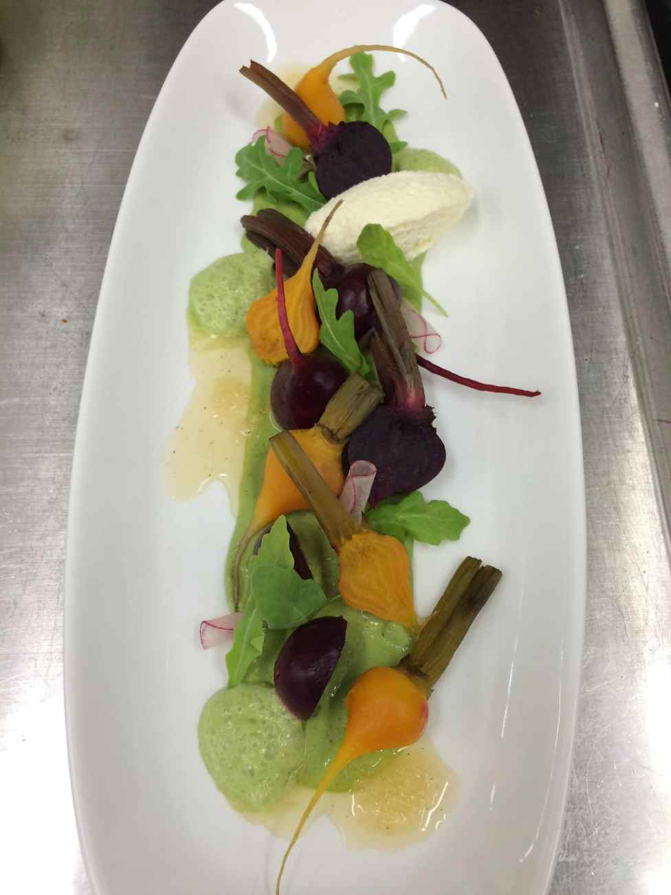 Baby beets with a pistachio basil cream sauce and white honey balsamic vinaigrette
