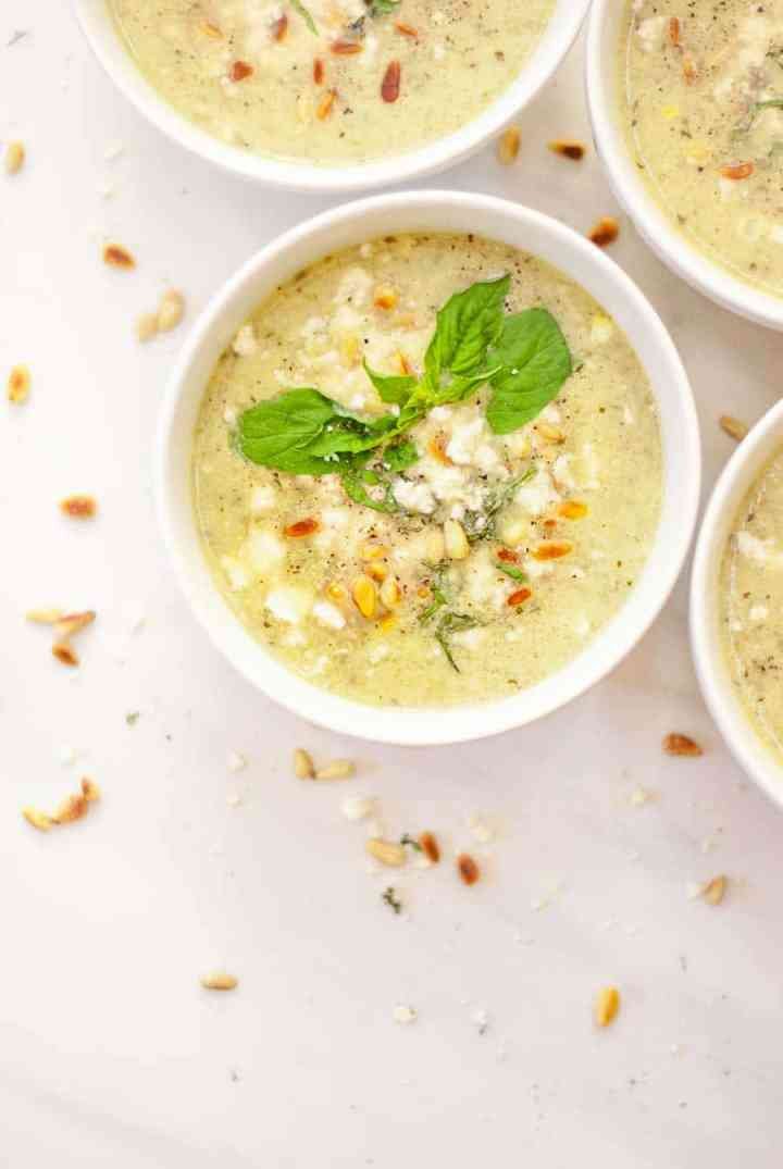 Summer Corn and Zucchini Chowder Topped with Freshly Chopped Basil, Toasted Pine Nuts, and Crumbled Feta Cheese! This healthy summer recipe is vegetarian, only 187 calories, and loaded with vegetables.