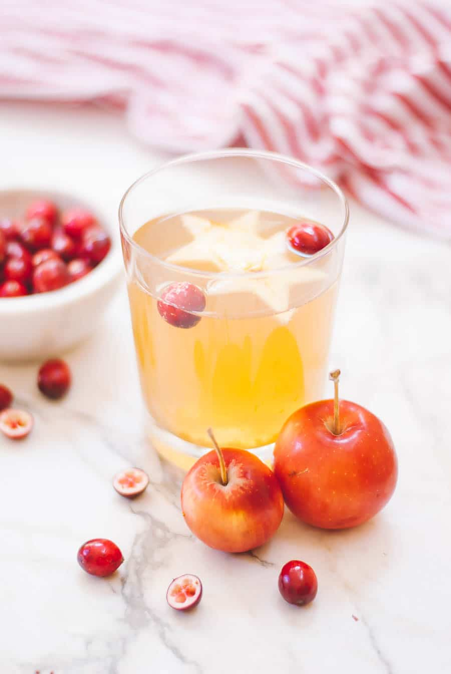 Holiday Cider with crab apples and cranberries in a bowl