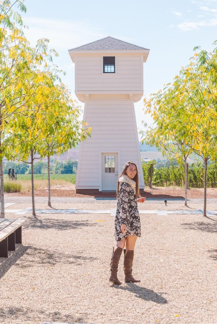 girl standing in front of the Silver Oak Winery iconic white water tower