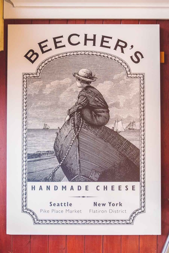 Beecher's Homemade Cheese logo poster hanging on a red wall