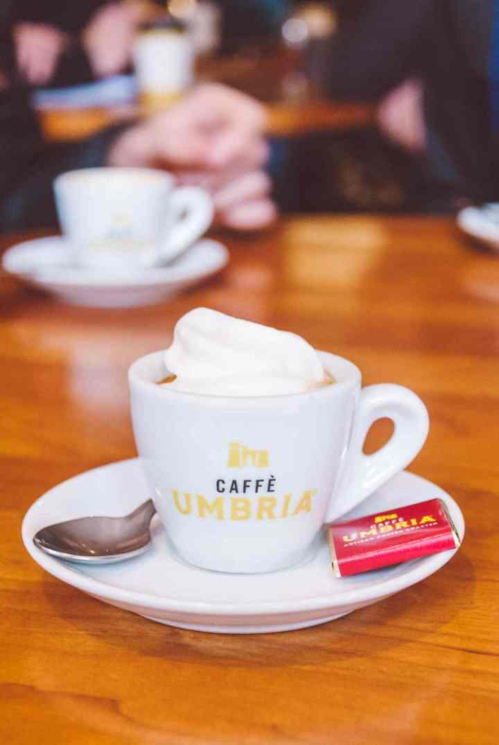 White cup full of Espresso con panna at Caffe Umbria