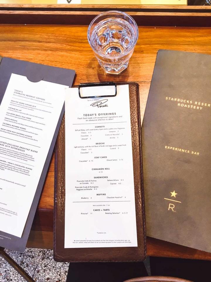 Starbucks Experience Bar menus on a wood table