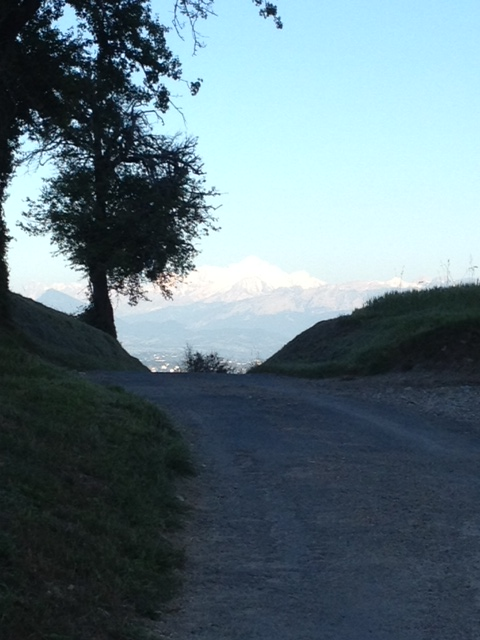 Mont Blanc on the other side of Lake Geneva, still bright in the setting sun.