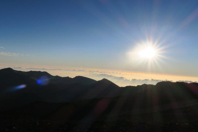 Just after dawn on Haleakala, a wild mix of clouds and colors.
