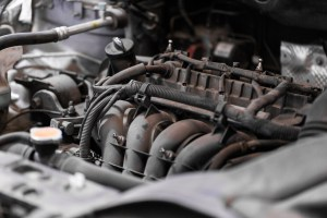 Under the hood of a car engine.