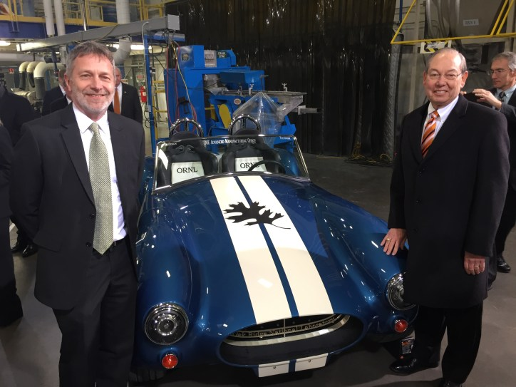 Chancellor Cheek standing next to 3D printed Shelby Cobra