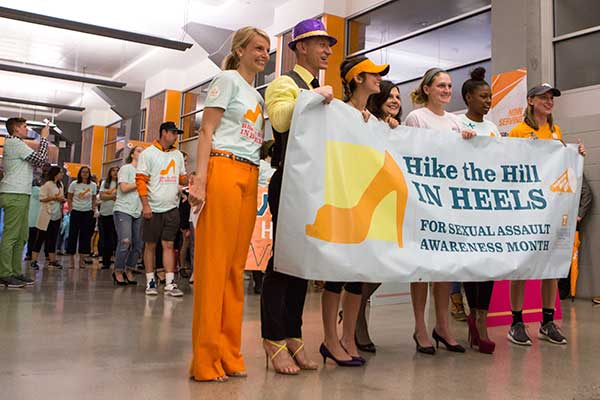 Ashley Blamey (left) with the Chancellor and students at the Hike the Hill in Heels event