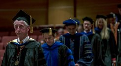 Lee Riedenger leads faculty processional