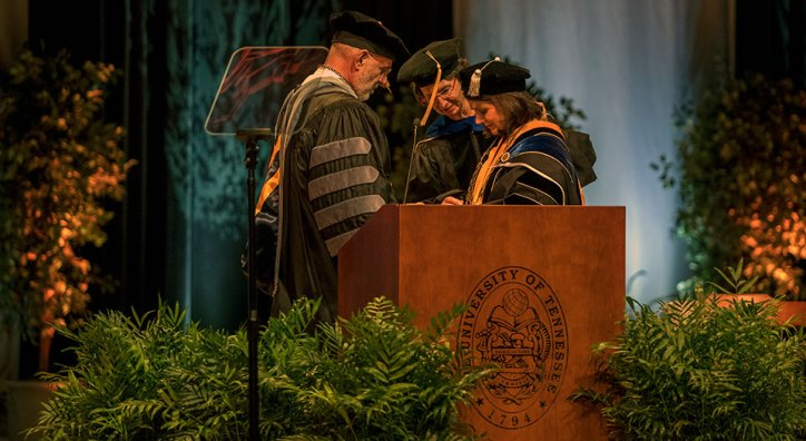 Conferring the medallion