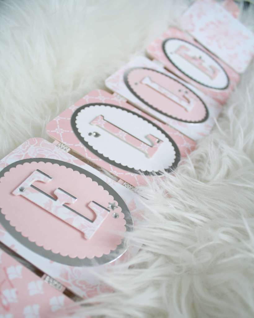 Handmade name banner in pink and white yardstick
