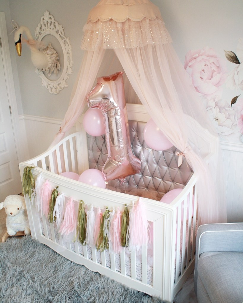 Easy first birthday ideas: Nursery and crib decorated for baby's first birthday