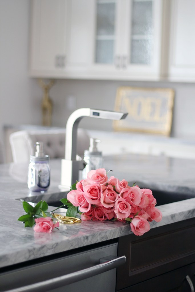Fresh pink roses in white kitchen - Glam Christmas Home Tour - Chandeliers and Champagne