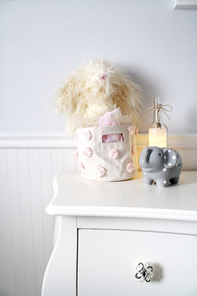 Pink and gray nursery with fuzzy Jellycat bunny