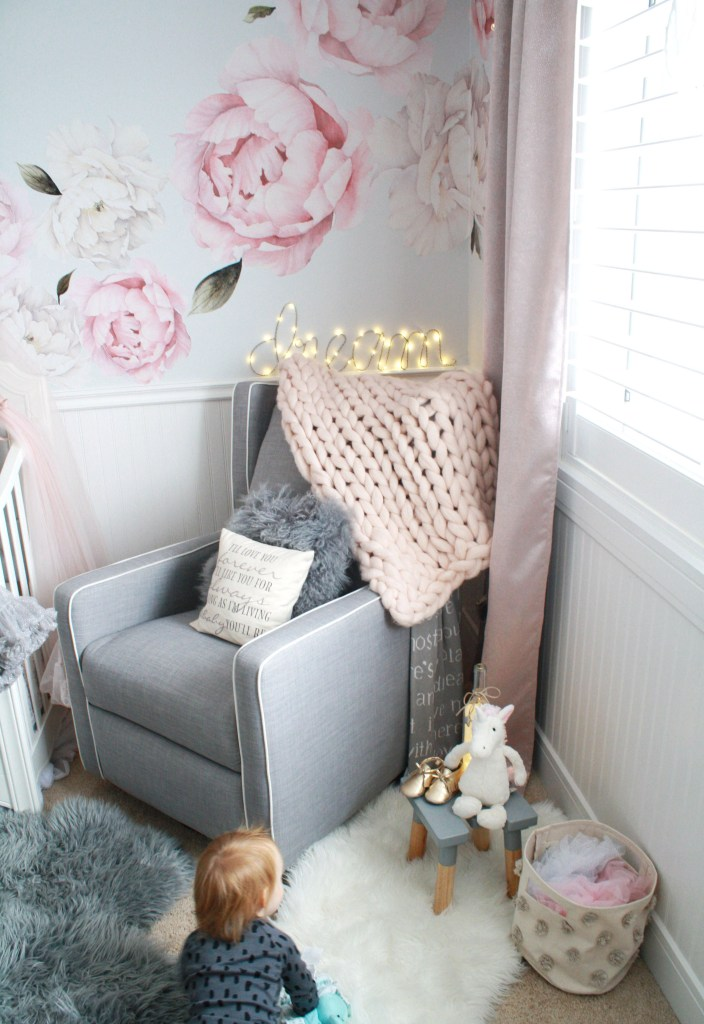 Pink and gray nursery featuring gray glider and peony wall decals