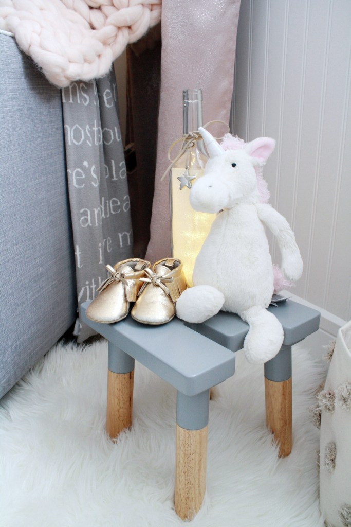 Pink and gray nursery with Jellycat unicorn stuffed animal