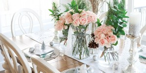 Chic Christmas Tablescape with White and Silver Accents and Pink Roses