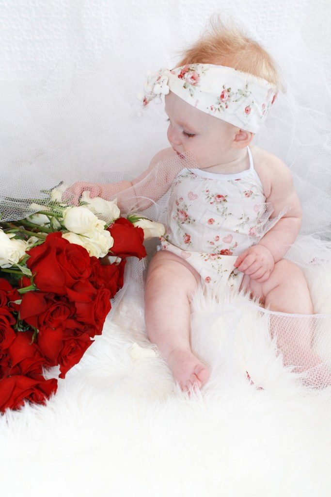 The cutest Valentine's Day outfits for baby girls and toddlers - white floral romper for baby girl