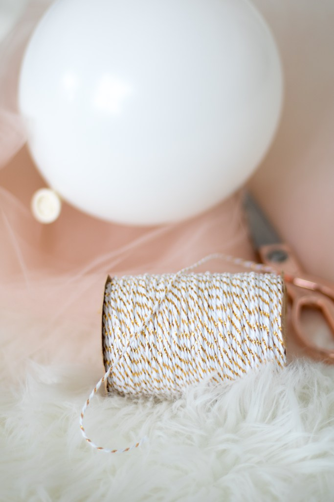 Crafting supplies including rose gold scissors for tulle balloon heart
