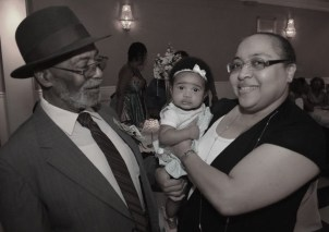 Daddy with his youngest great-grandchild at his 80th birthday party.