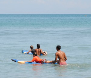 Children learning to surf with a private surf lesson in Bali