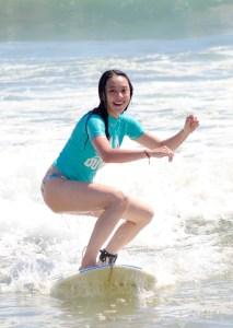 Surfing in Legian on a hard top board