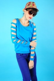 Electric blue sweatshirt with razor cut shoulders and sleeves Spike detail along the neckline 95% Cotton, 5% Spandex Hand wash with cold water. Do not bleach. Line Dry