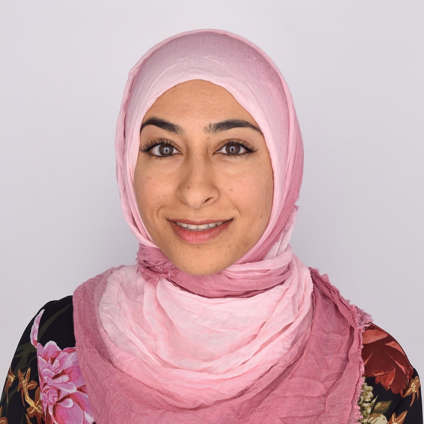 Muna Hussaini, an Indian-American woman wearing a headscarf.