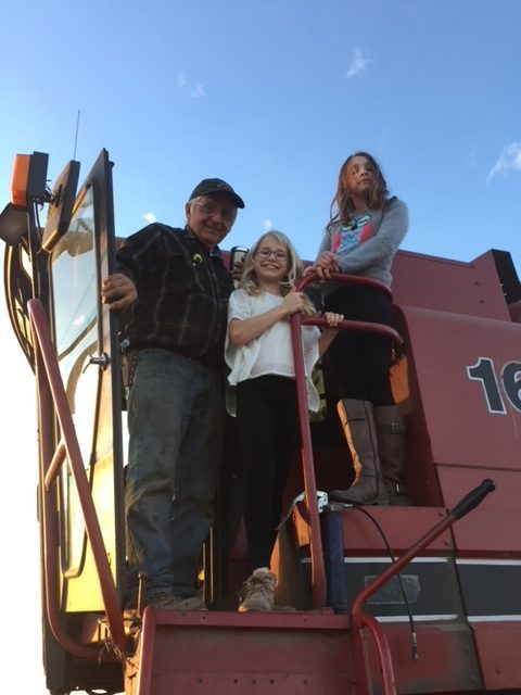 My dad and my girls on the combine