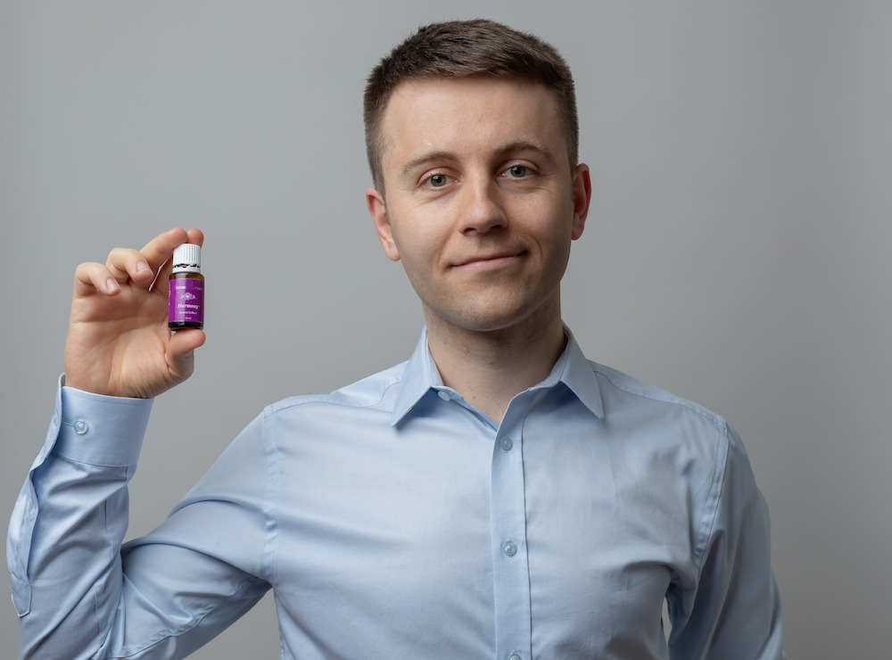 Bogdan holding a bottle of essential oil