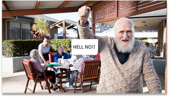 Picture of a Senior Center with a group of seniors sitting at a table, one of them standing and shaking his fist
