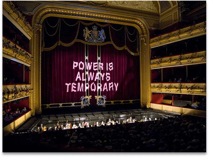 Theatre showing Tosca with a phrase projected onto the screen curtain, 'Power is always temporary'