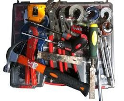 A diverse set of plumbing tools in a kit.