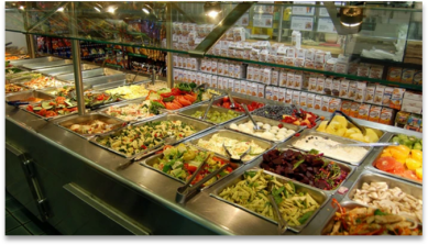 A buffet of many food choices in a restaurant.
