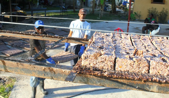 Workers make briquettes
