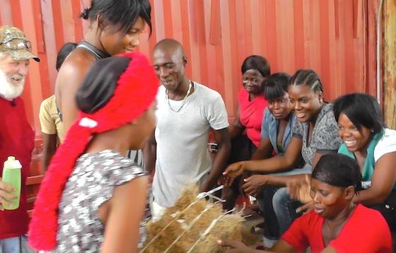 Women pass around vetiver Ubuntu Blox
