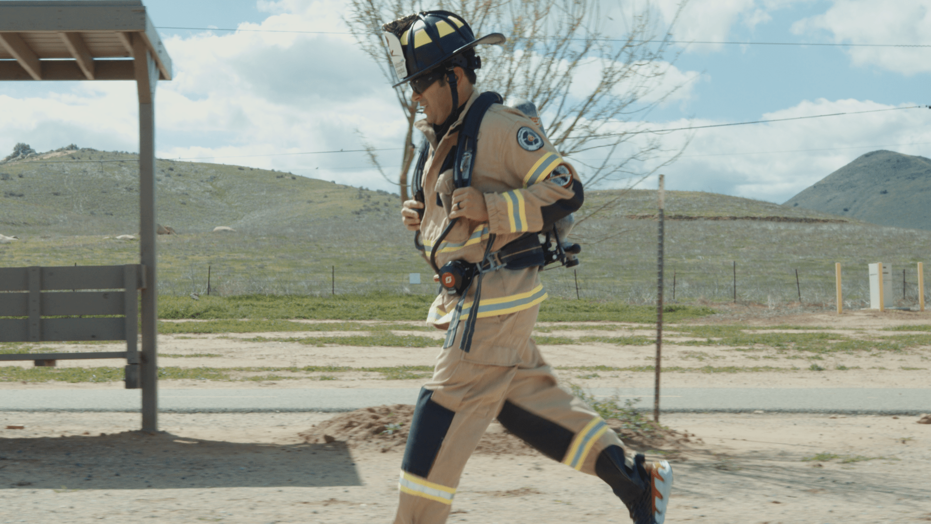 Jose Zambrano running in his firefighter gear.