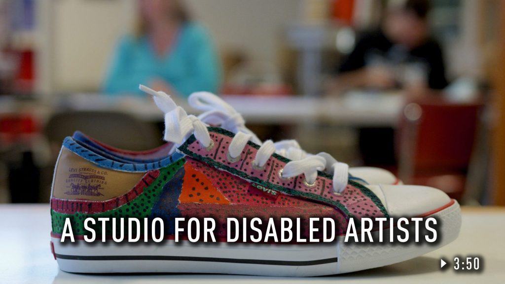 A sneaker painted by an artist at Kindling Studios.