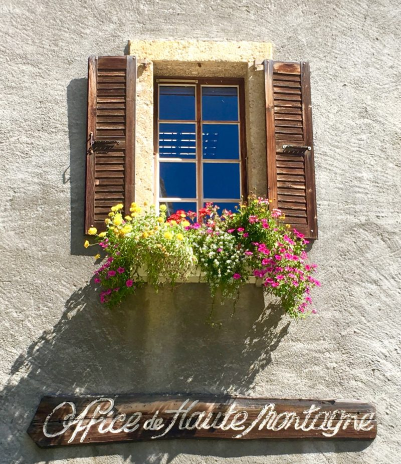 House of haute montagne building and window wth flowers in Chamonix | Changing Pages | Black Lion Journal hotel window