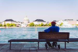 Man sitting near water - Independence - ChangingAging.org