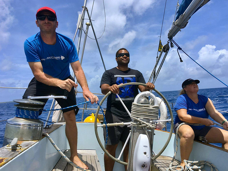 Students from YWAM ships learning navigation on Cloud Nine