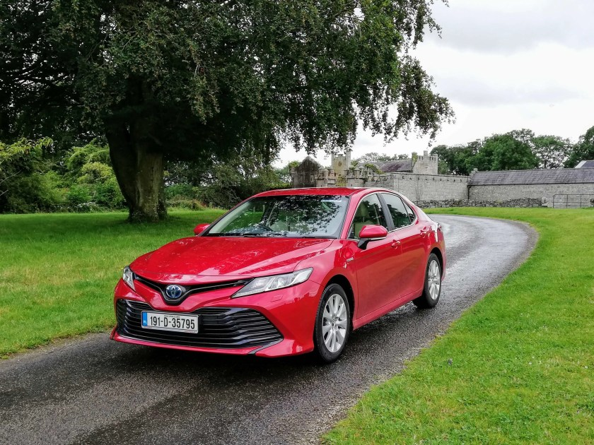 The Toyota Camry merges a super efficient hybrid powertrain with classic big car comfort and refinement