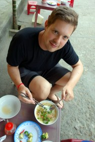 Crouched on a ridiculusly small stool down an alley eating delicious noodle soup (called bun gio cha nam nhieu rau or something like that)